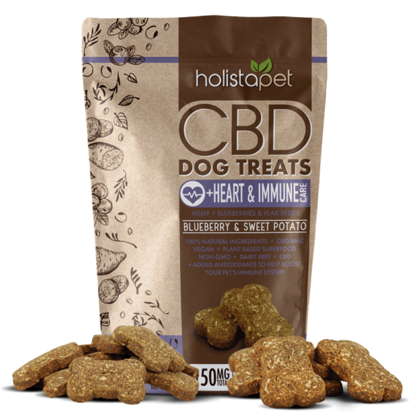 holistapet cbd heart and immune dog treats with blueberry and sweet potato treats laying out around bag